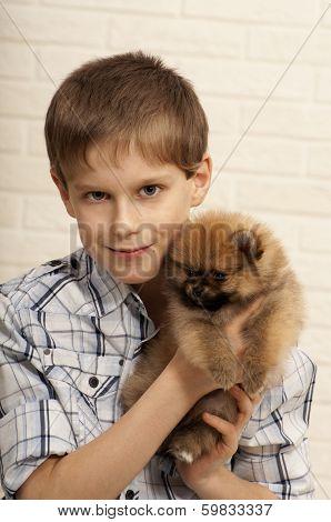 Boy with puppy.