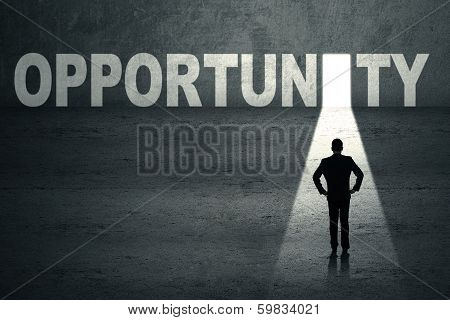 Businessman Looking At Opportunity Door