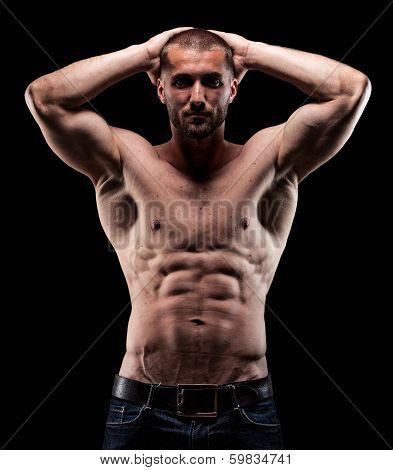 Attractive man with sixpack man witz sixpack and muscles