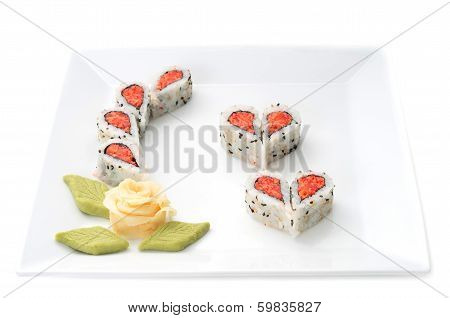 Sushi Forming Hearts And Flower Shapes On White Square Dish