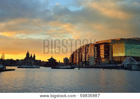 Amsterdam Waterfront And Skyline At Sunset