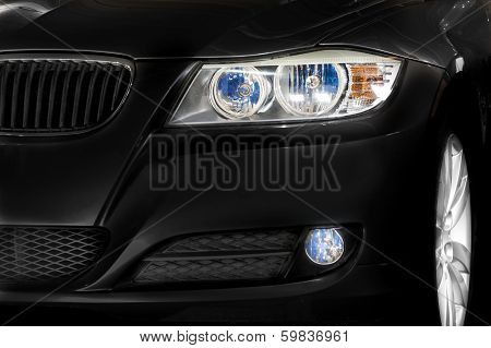 Black Car Headlights And Rim Details