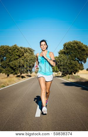 Woman Running Hard On Countryside Road