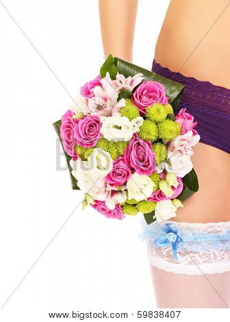 A picture of wedding flowers and a blue garter over white background