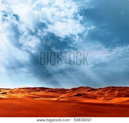 Beautiful landscape of Liwa desert, United Arab Emirates, Abu Dhabi, orange hot sand, blue cloudy sky, beauty of nature concept