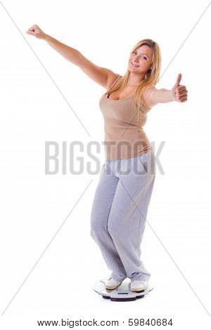 Woman Plus Size On Scale Celebrating Weightloss Thumb Up Isolated