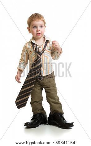boy playing with big father's shoes isolated