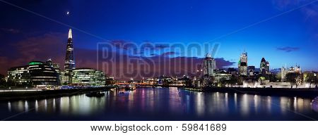 London skyline panorama at night, England the UK. Tower of London, The Shard, City Hall, River Thames as seen from Tower Bridge