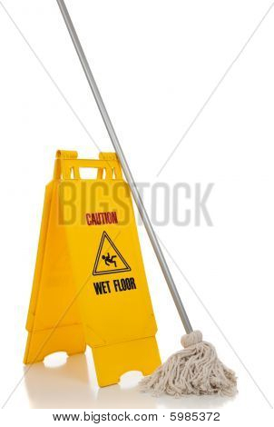Wet Floor Sign And Mop On White Background