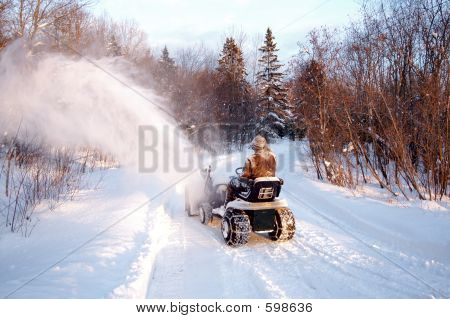 Man Blowing Snow