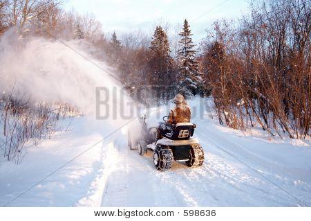 Man Blowing Snow
