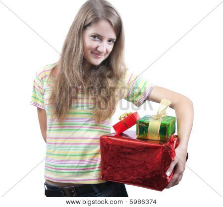 Beauty Girl With Christmas Gifts Over White