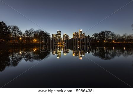 Midtown Atlanta night reflected in the lake at popular Piedmont Park.