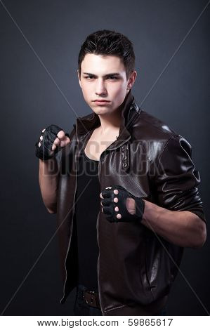 Agressive Muscular Young Man On Black
