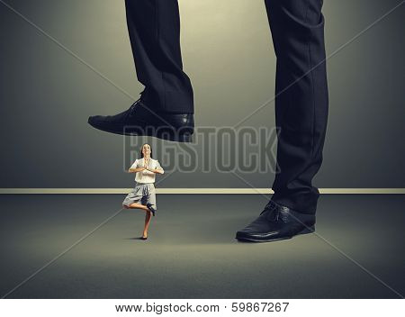 calm young woman under big leg his boss