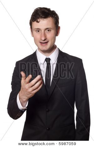 Young Businessman Is Talking To The Viewer Of This Picture