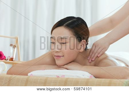 .a Young Woman Enjoying Massage.