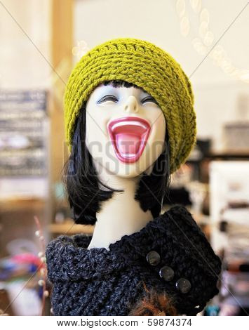 a pretty mannequin laughing