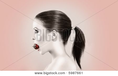 Beautiful Woman Biting Strawberry