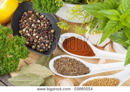 Herbs and spices on cutting board and wood table
