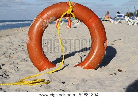 Life preservers in sand