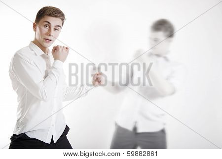 Shot Of Fighting Businessman.