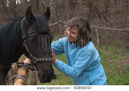 Woman And Black Horse