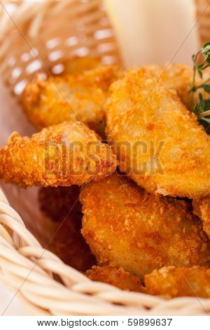 Crumbed Chicken Nuggets In A Basket