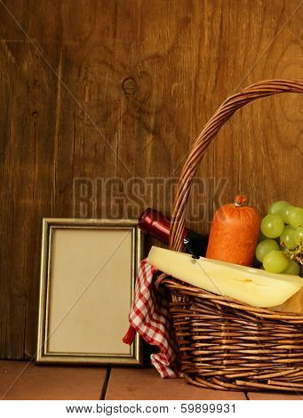 picnic basket - wine, fruit, cheese and sausage