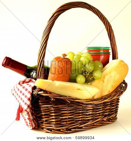 picnic basket - wine, fruit, cheese and sausage, toned photo