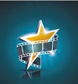 stock photo of strip  - Film strip roll with gold star - JPG