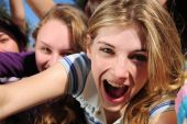 foto of groupies  - crowd of crazy teen girls celebrating a famous star on the red carpet - JPG