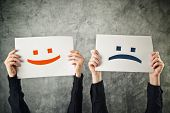 stock photo of emoticons  - Happy and sad face - JPG