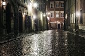picture of paving  - A street in the old town of Warsaw at night - JPG