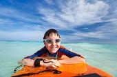 image of boogie board  - Little boy on vacation having fun swimming on boogie board - JPG