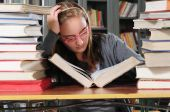 image of midterm  - Teenager girl studying for her midterm in a library - JPG