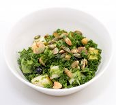 stock photo of kale  - Kale salad with pear pumpkin seed blueberry in white bowl on white background - JPG