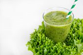 pic of cucumbers  - Fresh organic green smoothie with salad apple cucumber pineapple and lemon as healthy drink - JPG