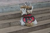 picture of mummer  - Colorful theatrical mask of mummer sitting on the staircase