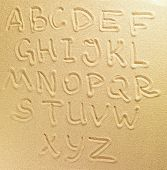 stock photo of letter j  - Alphabet letters handwritten in the sand on the beach - JPG