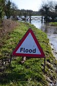stock photo of flood  - Flood warning traffic sign near the River Cuckmere in Sussex - JPG