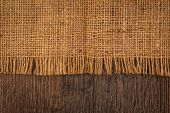 image of taupe  - Textured background of a sandy brown burlap cloth - JPG
