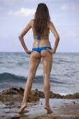 Woman In Bikinis On The Beach