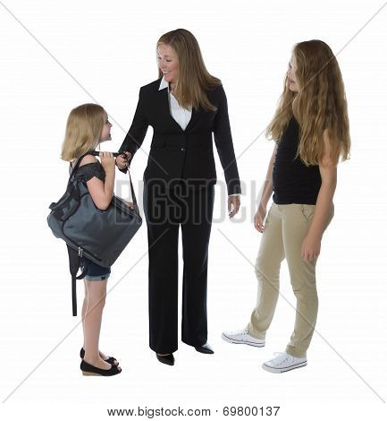 Mother Being Greeted By Her Daughters After She Gets Home From Work