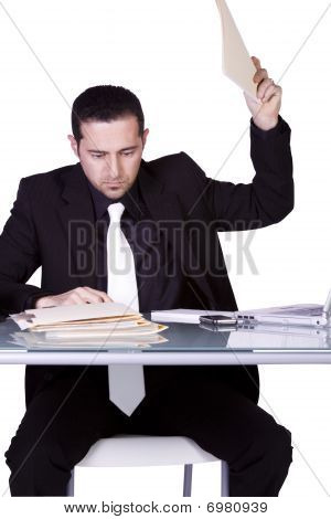 Upset Businessman At His Desk In Suit