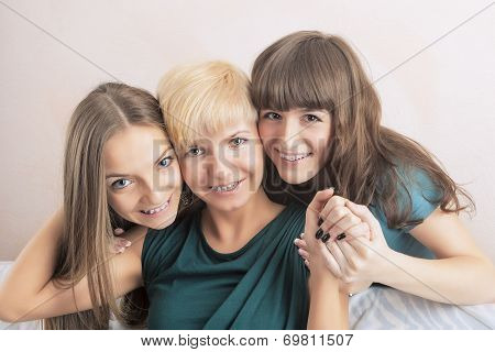 Dental Health And Hygiene Concepts: Three Young Ladies With Teeth Braces Together In Home Environmen