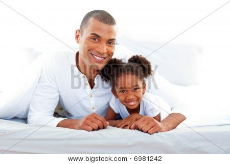 Caring Father And His Daughter Smiling At The Camera