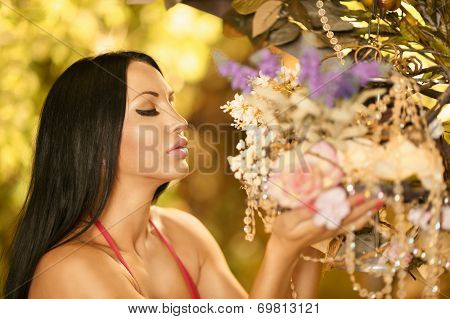 Brunette sniffed the flowers