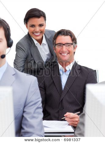 Two Smiling Colleagues At Work