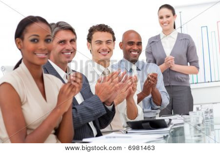 Happy Business Team Applauding A Good Presentation